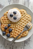 Waffle with cream and blueberries Royalty Free Stock Photos