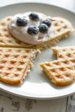 Waffle with cream and blueberries Stock Photos