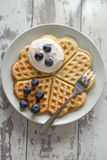 Waffle with cream and blueberries Stock Image