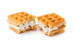 Waffle with cream a broken in half. Royalty Free Stock Image