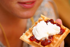 Waffle with cream in hand stock photo