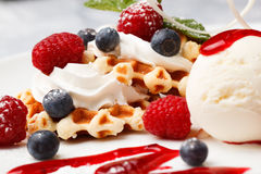 Waffle with cream, ice cream and fresh berries Stock Images