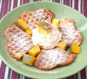 Waffle with cream and mango Royalty Free Stock Images