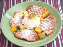 Waffle with cream and mango Stock Photos