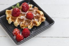 Waffle with cream raspberries and chocolate strawberries Royalty Free Stock Images