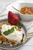 Waffle with cream raspberries and chocolate strawberries Royalty Free Stock Image