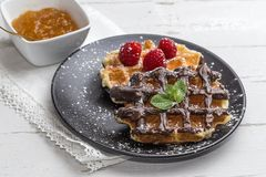 Waffle with cream raspberries and chocolate strawberries Royalty Free Stock Photo