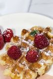Waffle with cream raspberries and chocolate strawberries Royalty Free Stock Photos