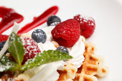 Waffle and cream topped with fresh berries Royalty Free Stock Photography