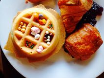Waffle and croissant Royalty Free Stock Photography
