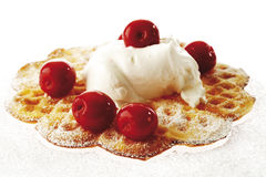 Waffle decorated with cream and cherries Stock Photos