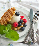 Waffle decorated with ice cream scoop and berries Stock Photo