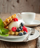 Waffle decorated with ice cream scoop and berries Royalty Free Stock Images