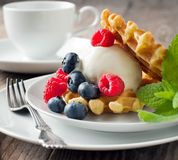Waffle decorated with ice cream scoop and berries Royalty Free Stock Photography