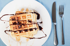 Waffle with a drizzle of chocolate and caramel syrup Stock Photography