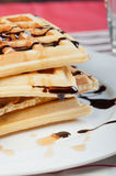 Waffle with a drizzle of chocolate and caramel syrup Royalty Free Stock Photo