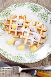 Waffle with easter egg on a plate Stock Image