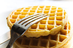 Waffle and fork. Waffle on plate with fork on top Royalty Free Stock Photo