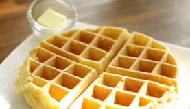 Waffle. Fresh made waffle with butter in the morning sun light royalty free stock photo