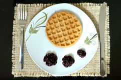 Waffle and Fruit Jam. Waffle, Fruit Jam, knife and fork on the table Royalty Free Stock Image