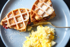 Waffle fruit sandwiches with scrambled eggs Royalty Free Stock Photo