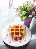 Waffle with grape sauce. Stock Photography