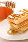 Waffle with honey Stock Images