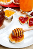 Waffle with honey and jam on a dish Stock Image