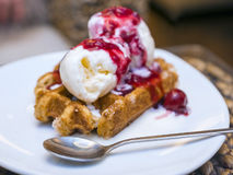 Waffle with ice cream and cherry Stock Photo