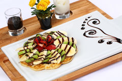 Waffle with ice cream and coffee. Delicious home-made waffle with some slices of fresh fruits royalty free stock photo