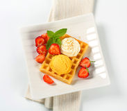Waffle with ice cream and strawberries Stock Photos