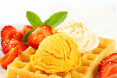 Waffle with ice cream and strawberries Stock Image