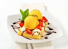 Waffle with ice cream and strawberries Royalty Free Stock Images