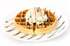 Waffle and ice cream on white dish. Waffle top up with vanilla ice cream on white dish stock photos