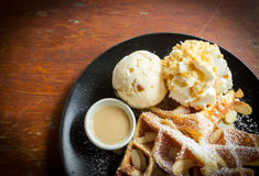 Waffle with icecream on black plate. Royalty Free Stock Photo