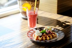 Waffle with icecream and glass of smoothie Royalty Free Stock Images