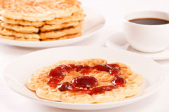 Waffle with jam and coffee. Waffle with strawberry jam and coffee. Waffles in background Stock Image