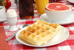 Waffle and maple syrup Stock Images