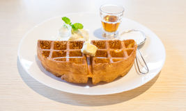 Waffle with maple syrup and butter Royalty Free Stock Image