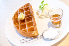 Waffle with maple syrup and butter Royalty Free Stock Photography