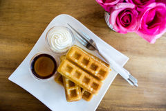 Waffle with maple syrup Royalty Free Stock Photo