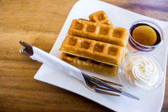 Waffle with maple syrup Royalty Free Stock Images