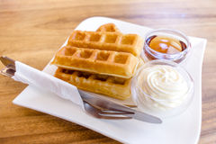 Waffle with maple syrup Royalty Free Stock Image