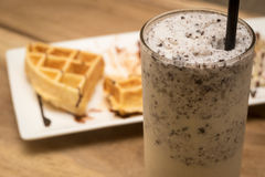 Waffle and milk shakes. On wood table, selective focus point royalty free stock image