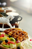 Waffle pour chocolate sauce and fruit mixed Served whipping cream and drink with Hot cappuccino for appetizer. Background Stock Photography