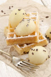 Waffle with powdered sugar on paper Royalty Free Stock Image