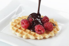 Waffle with raspberry and chocolate Stock Image
