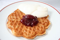 Waffle with raspberry jam and cream. Swedish waffle with jam and cream, delicious Stock Image