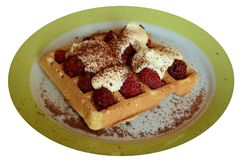 Waffle with raspberry. On the plate Stock Image