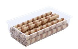 Waffle rolls with chocolate cream into box. Stock Image